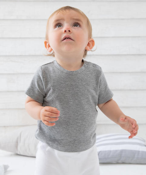 A toddler modelling a t-shirt