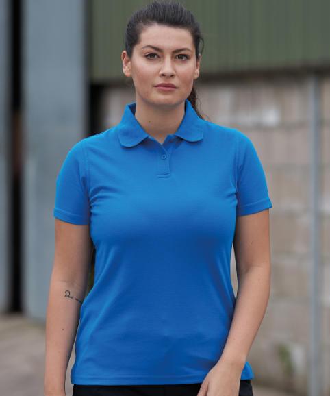 A woman modelling a polo shirt